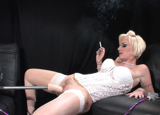 Blonde smoking slut Emma Louise gets fucked by the machine
